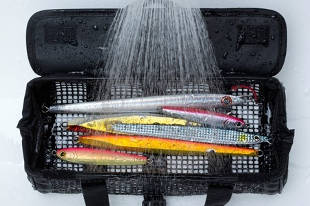 Rinse or dunk jig mesh bag into fresh water to clean your tackle